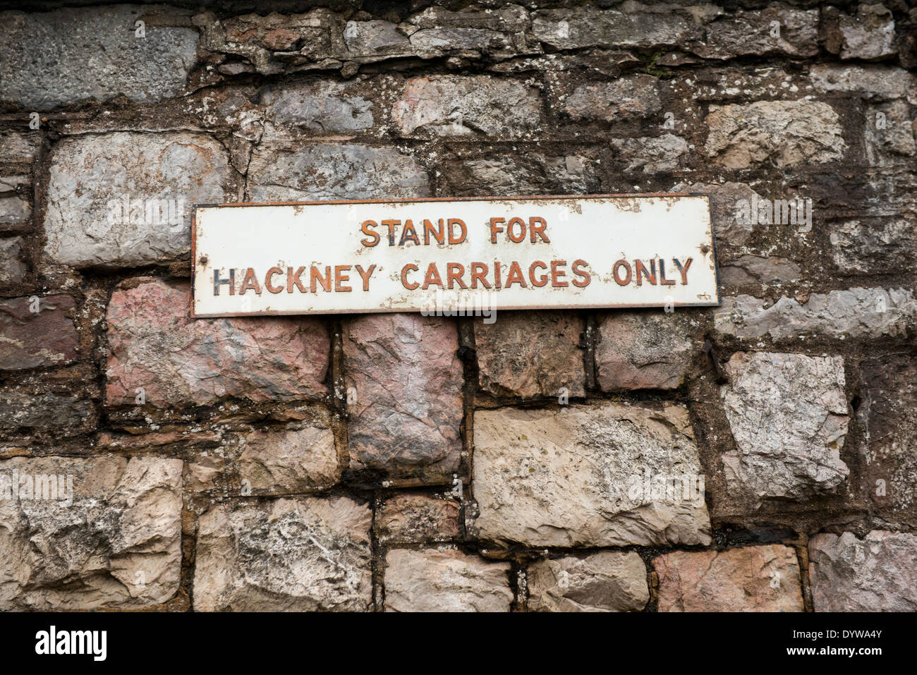 Sign saying 'Stand for Hackney Carriages Only' at the railway station in Dawlish, Devon - Stock Image