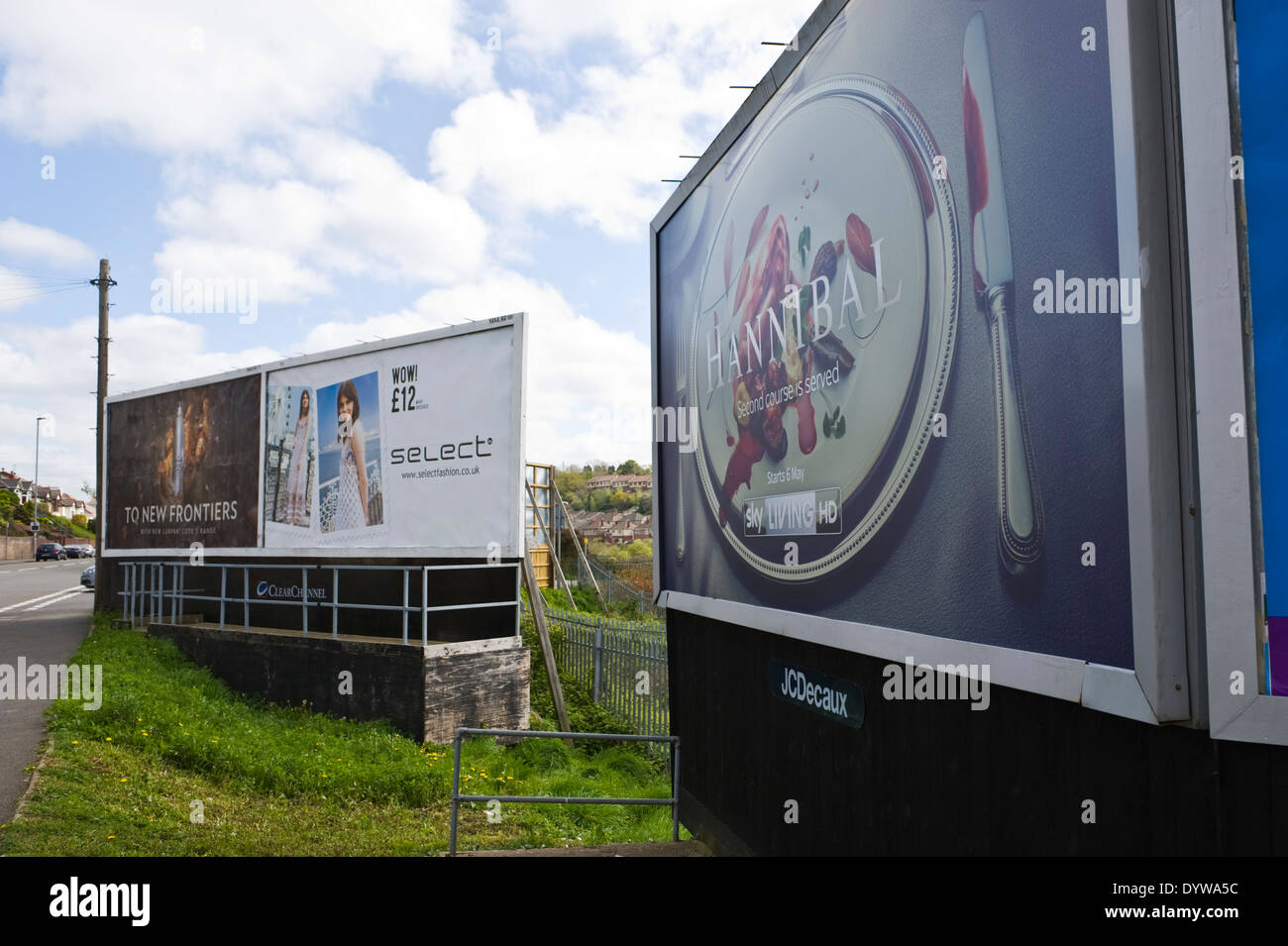 JCDecaux & ClearChannel advertising billboards on roadside site in Newport South Wales UK - Stock Image