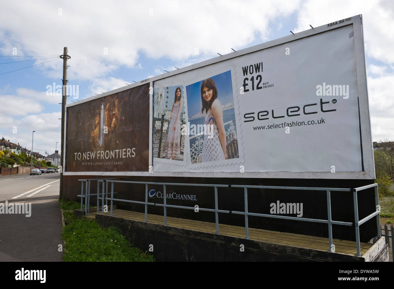 Lurpak cooking mist & Select fashion advertising billboards on ClearChannel roadside site in Newport South Wales UK - Stock Image