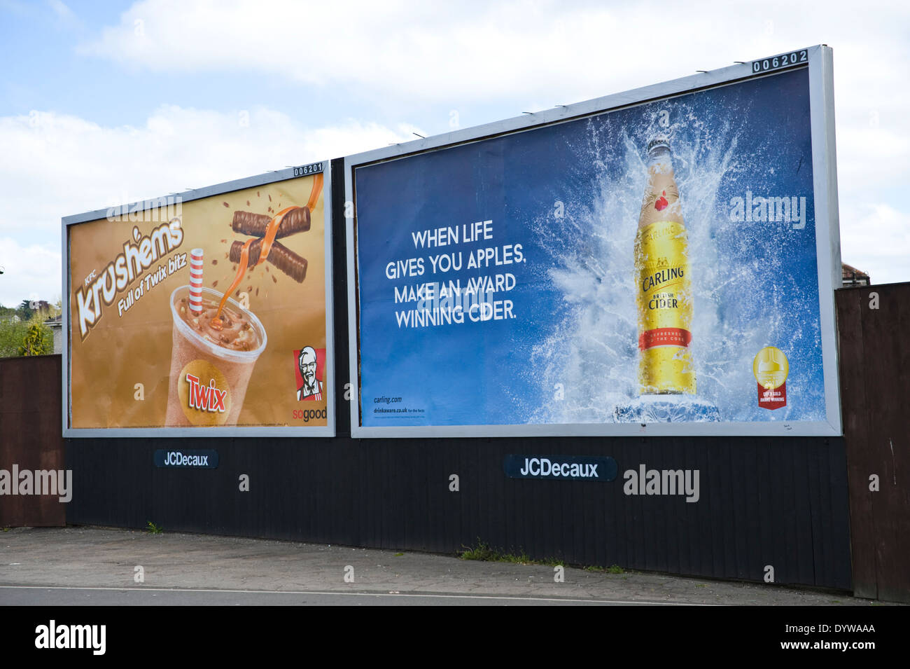 KFC Krushems with Twix & Carling Cider advertising billboards on JCDecaux roadside site in Newport South Wales UK - Stock Image