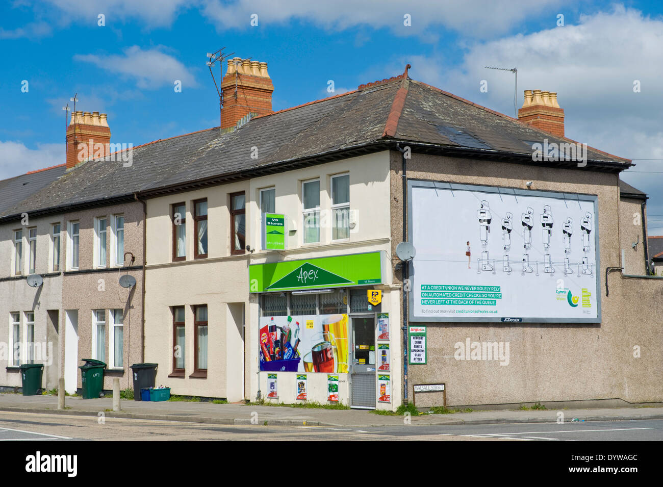 Wales Credit Unions advertising billboard on end wall of corner shop JCDecaux site in Newport South Wales UK - Stock Image