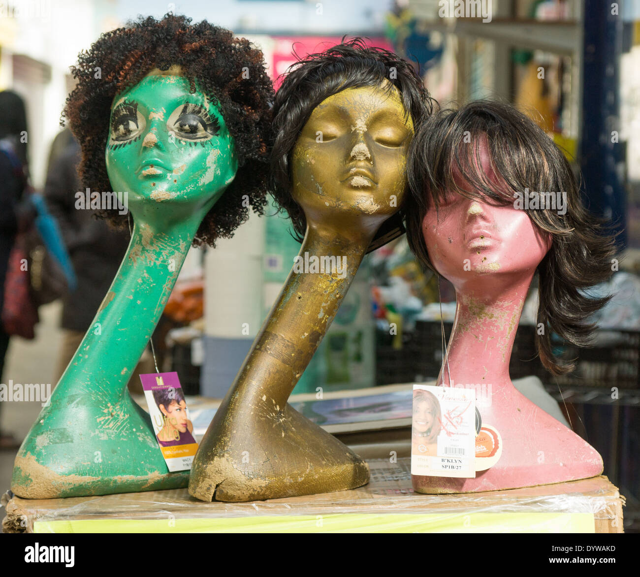wigs on dummy.  Afro wigs for sale in Brixton Market - Stock Image