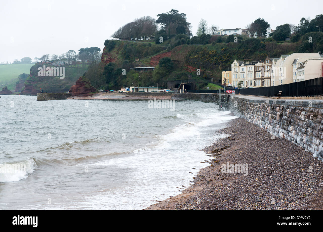 Beach and newly re-opened railway track after the 2014 storm damage in Dawlish, Devon UK - Stock Image