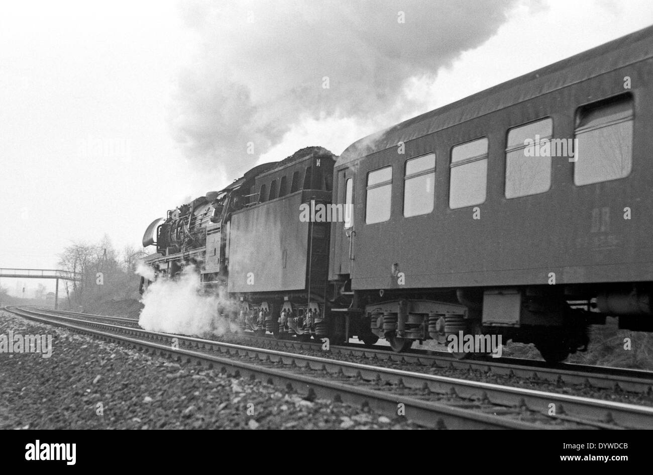 Berlin, DDR, steam locomotive with freight train on tracks - Stock Image