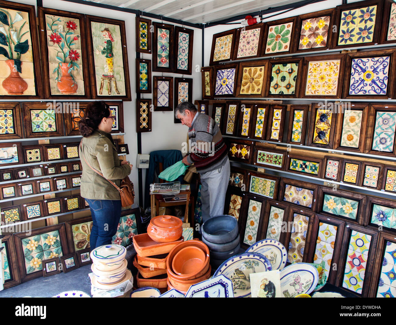 Salesman in Aveiro selling traditional paintings with Azulejo tiles - Stock Image