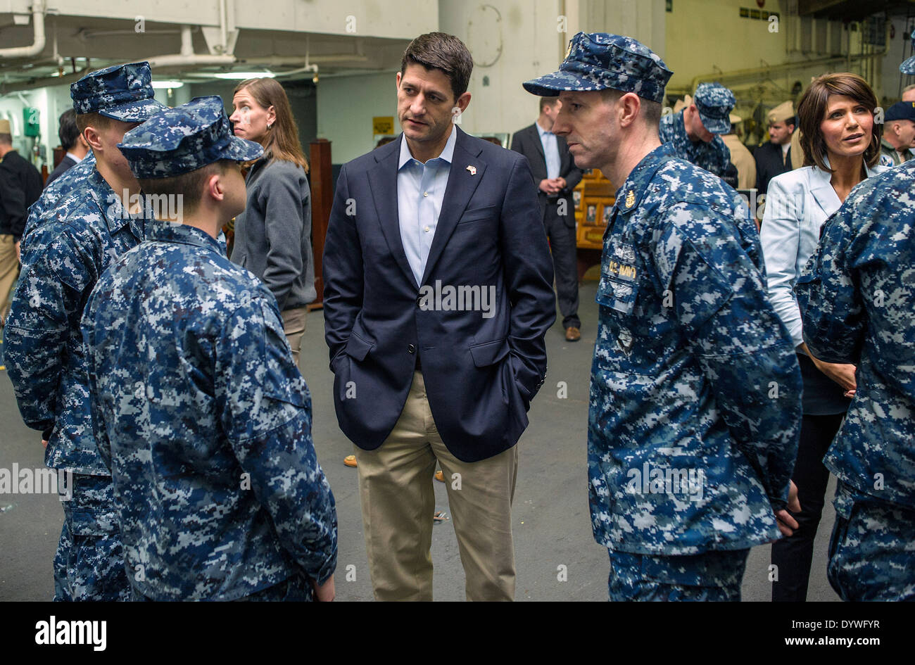 US Rep. Paul Ryan, center, speaks to Sailors in the hangar bay of the nuclear aircraft carrier USS George Washington - Stock Image