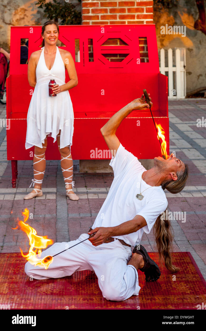 A Fire-Eater Performs At The Sunset Celebration, Mallory Square, Key West, Florida, USA - Stock Image