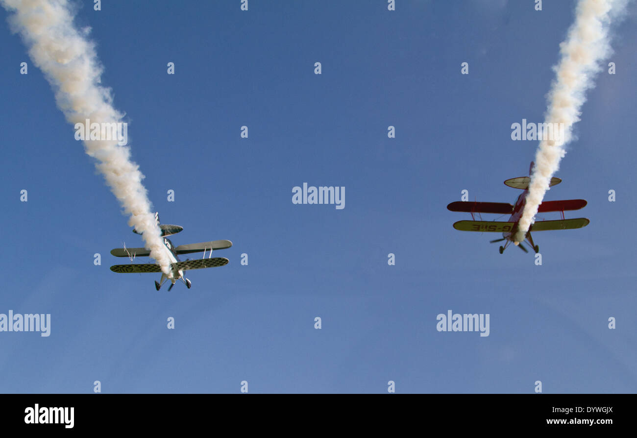 WildCats Aerobatic Display Team from Old Buckingham airfield fly overhead with smoke on - Stock Image