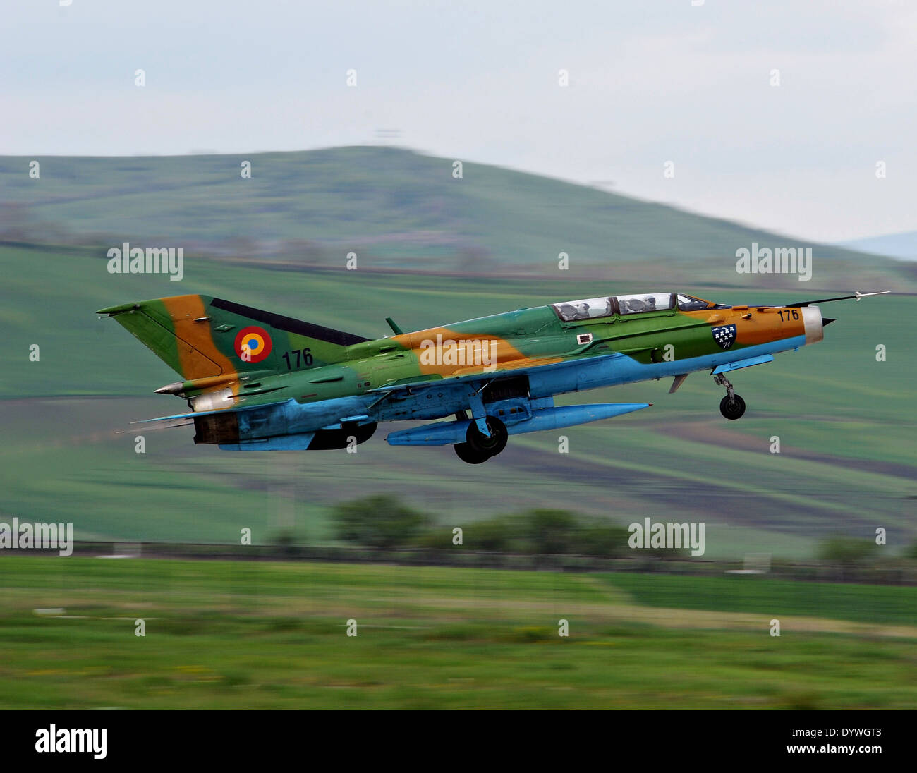 A Romanian Air Force MiG-21 Lancer fighter aircraft takes off during exercise Dacian Viper April 17, 2014 in Campia Turzii, Romania. Dacian Viper is a bilateral air exercise between the US Air Force and the Romanian Air Force. - Stock Image