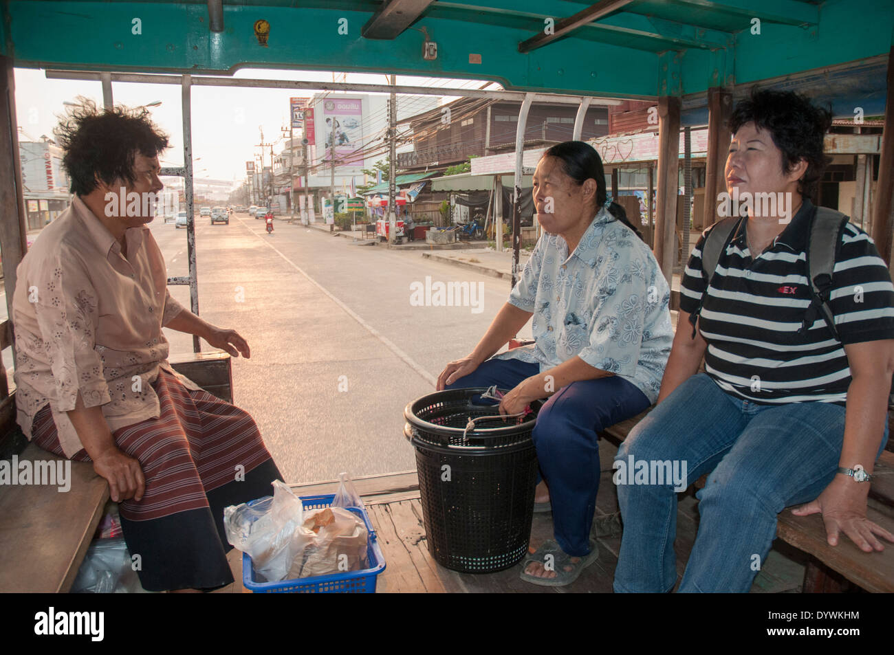 Riders aboard an old-fashioned songthaew truck in Sukhothai, Thailand - Stock Image