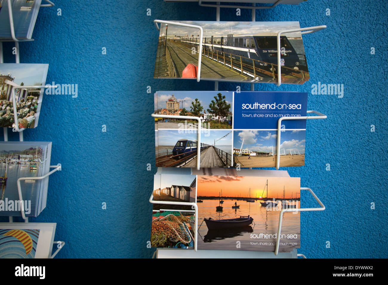 Postcards for sale in Southend-on-Sea, Essex, England, UK. The Southend postcards are displayed in a rack on a blue background. - Stock Image
