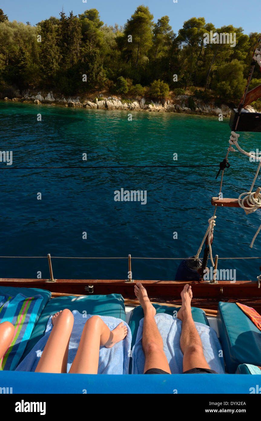 Couple on deck of yacht sailing near the island Lefkas. MS Christina Cruises in Ionian Sea, Lefkas, Ionian Islands, Greece - Stock Image