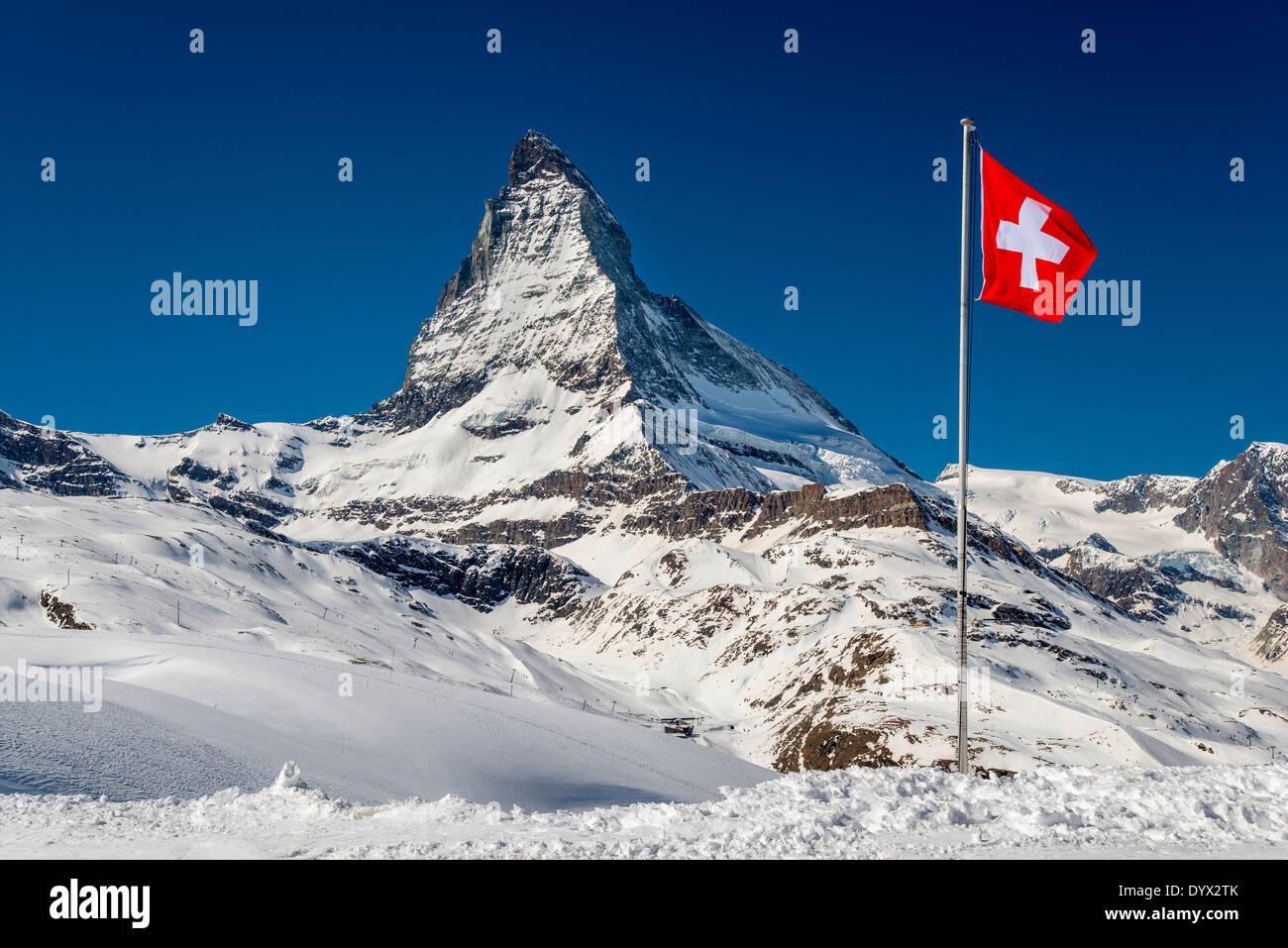 Winter view of Matterhorn with Swiss flag, Zermatt, Wallis or Valais, Switzerland - Stock Image