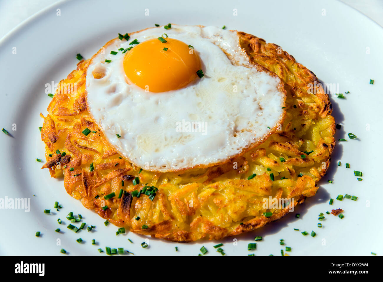 Rosti with fried egg, a traditional swiss dish, Zermatt, Wallis or Valais, Switzerland - Stock Image