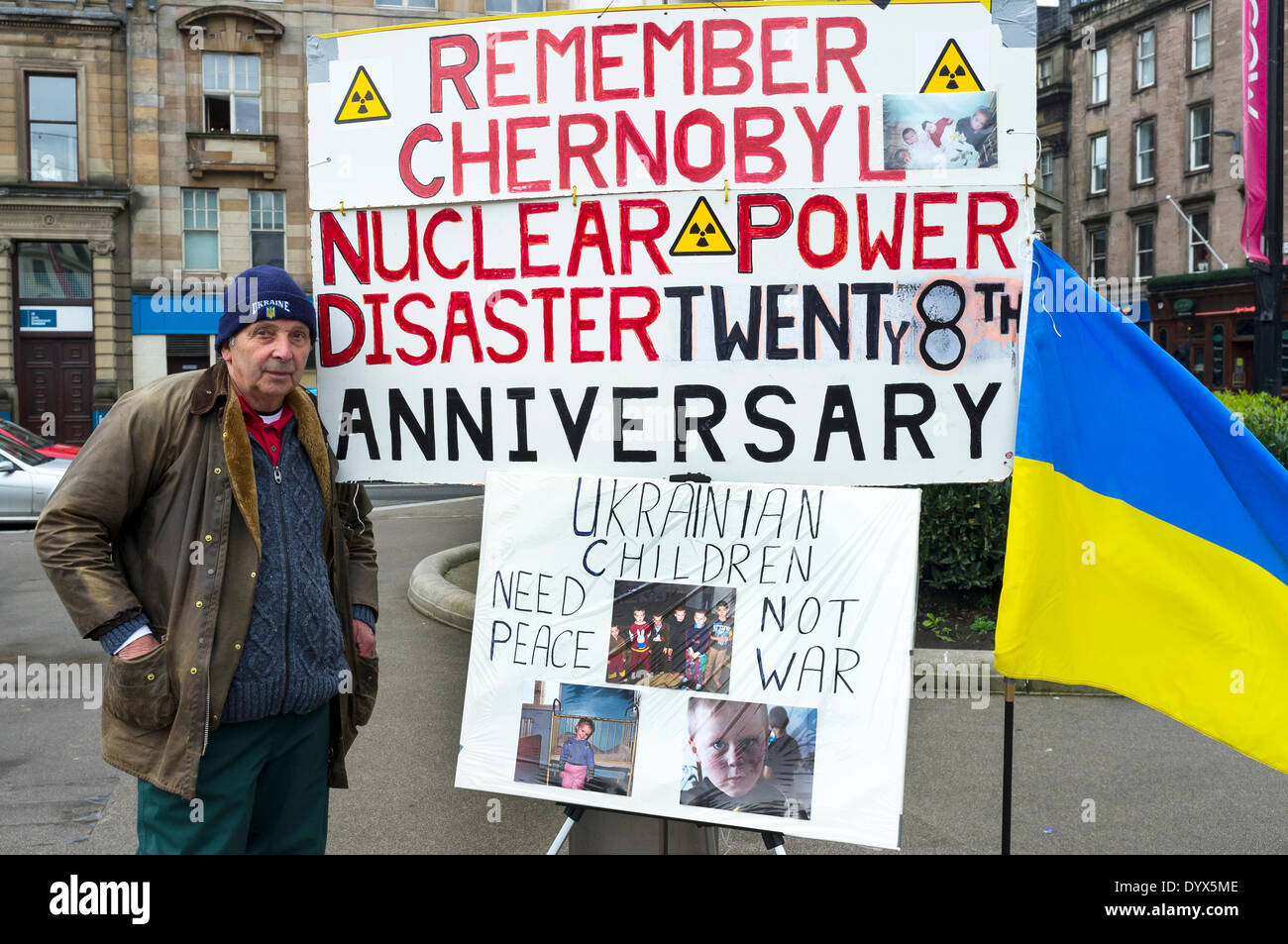 Glasgow, Scotland, UK. 26th Apr, 2014. Jim Gillies, aged 74, retired electrician from Cumbernauld near Glasgow, Scotland, UK, has carried out a 'one man' remembrance vigil, every year for the past 27 years, on the anniversary of the nuclear power plant explosion at the Ukrainian reactor in Chernobyl where 31 people died and 500,000 people were affected. Jim Gillies has visited the disaster area 16 times carrying out humanitarian work and has also been on the 'Black Tour' around the radioactive plant. Credit:  Findlay/Alamy Live News - Stock Image