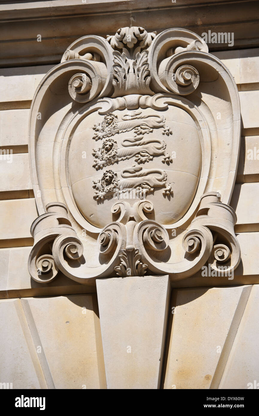 Stone carving on the wall of the Old War office in London, England, United Kingdom. - Stock Image