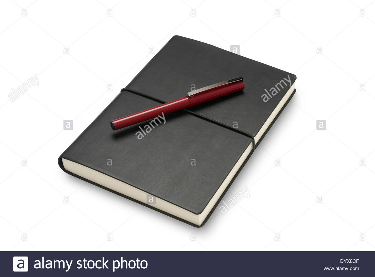 Black journal or notebook closed with a red pen. Isolated on white with path - Stock Image