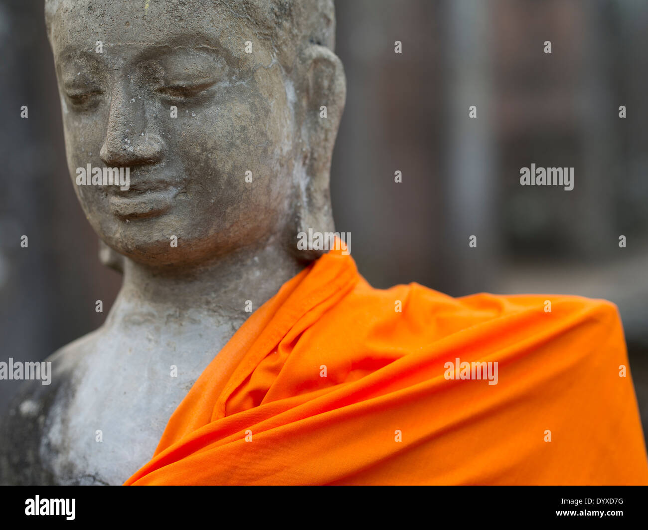 Buddhist statue in orange robes at Bayon Temple, Angkor Thom, Siem Reap, Cambodia - Stock Image