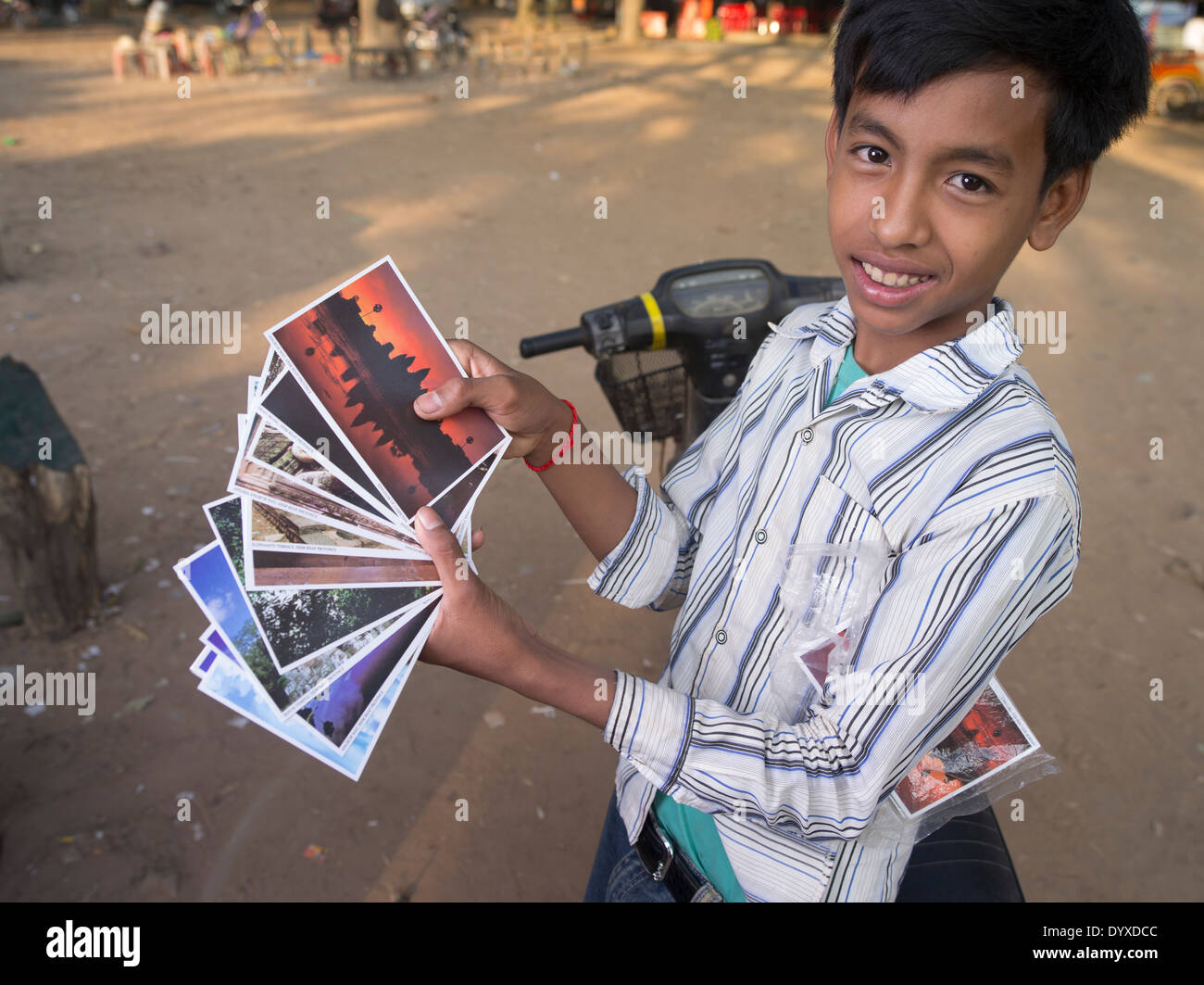 Young Cambodian boy selling postcards at Angkor Wat Temple, Siem Reap, Cambodia - Stock Image