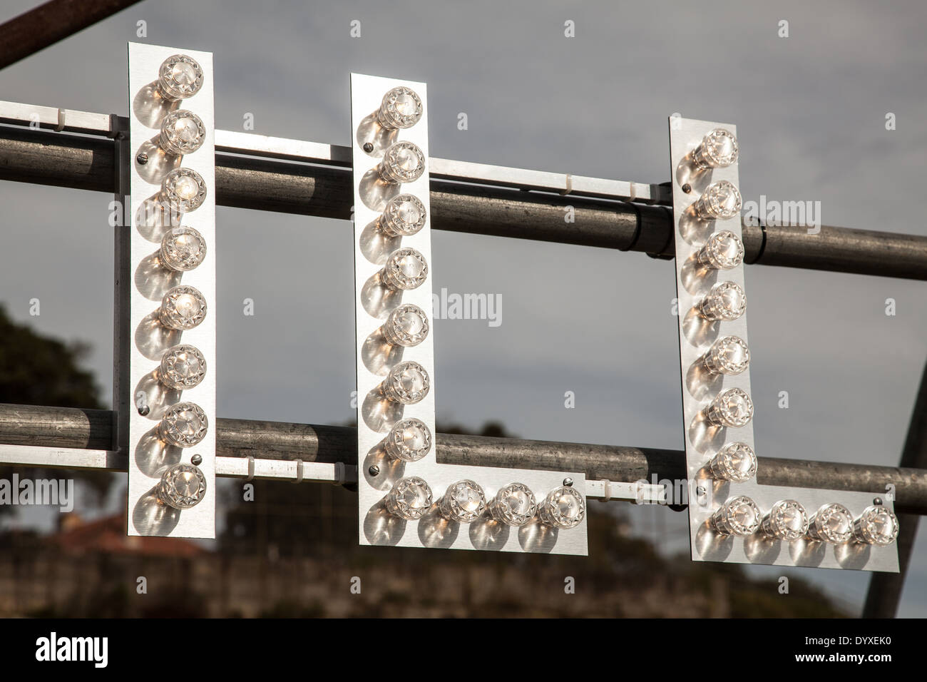 Part of an artistic installation with letters in lights abstracted to 'ILL' - Stock Image
