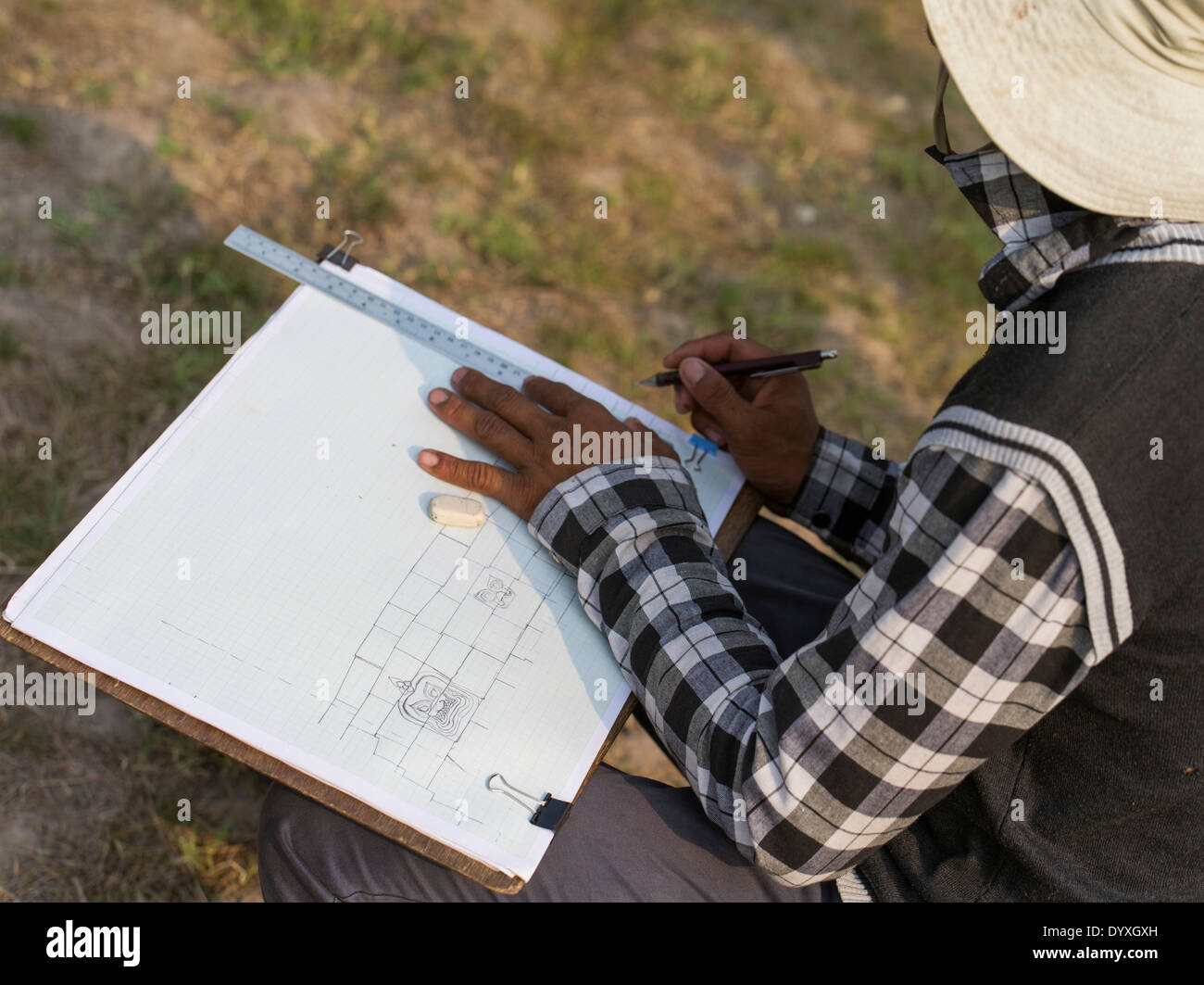 Member of a preservation team draws the current location of stones,Terrace of Elephants, Angkor Thom Temple, Siem Reap, Cambodia - Stock Image