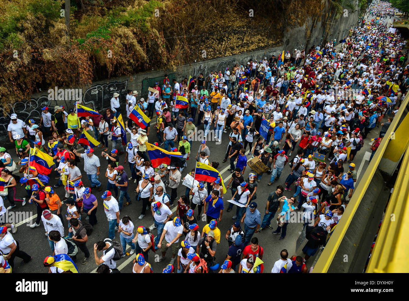 Caracas, Venezuela. 26th Apr, 2014. People participate during a march under the slogan 'The education is respected', at Chacao township, in Caracas, Venezuela, on April 26, 2014. © Carlos Becerra/Xinhua/Alamy Live News - Stock Image