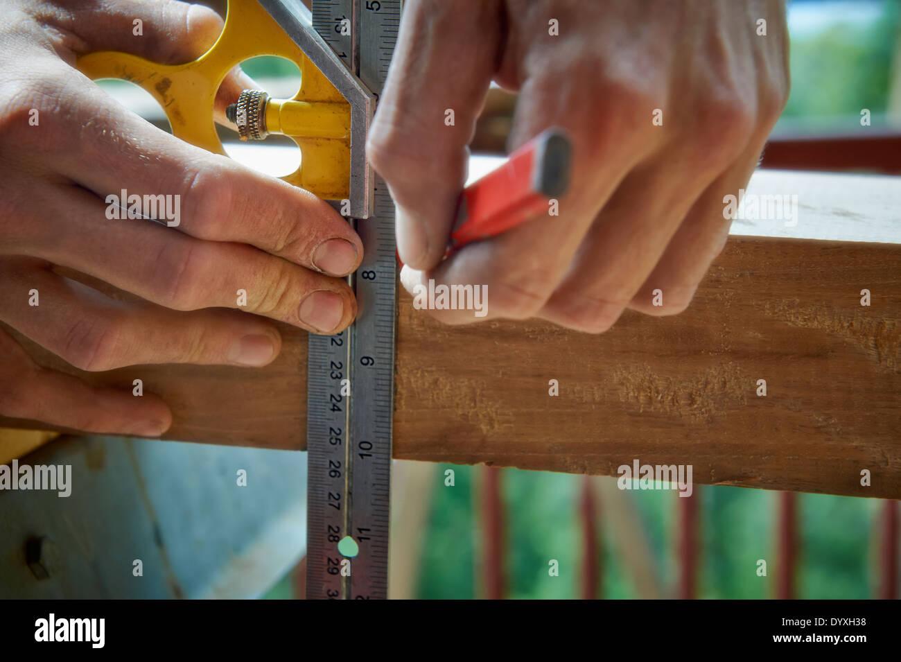 Carpenter using combination sqaure, Australia Stock Photo