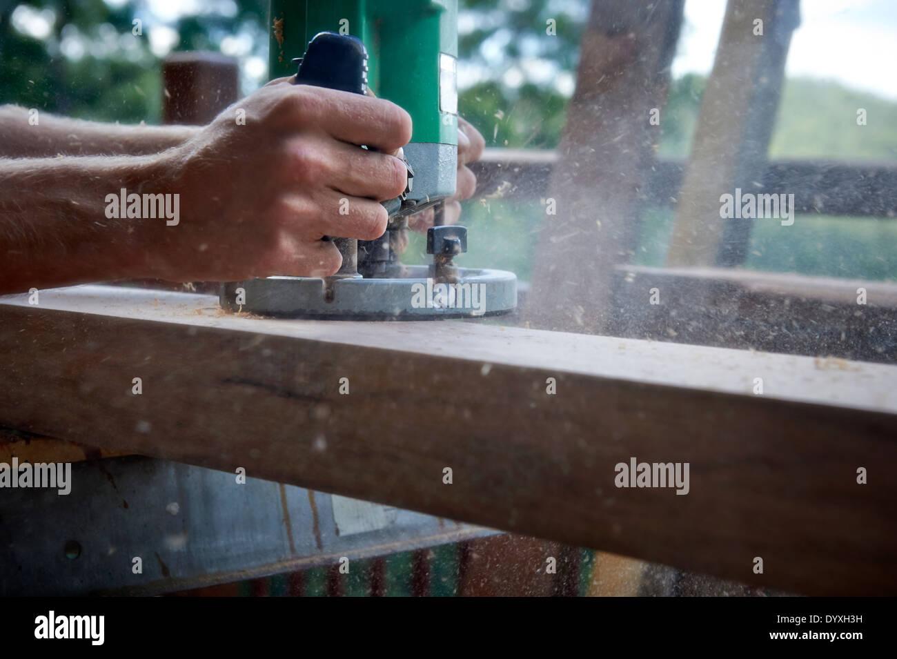 Carpenter using router, Australia - Stock Image