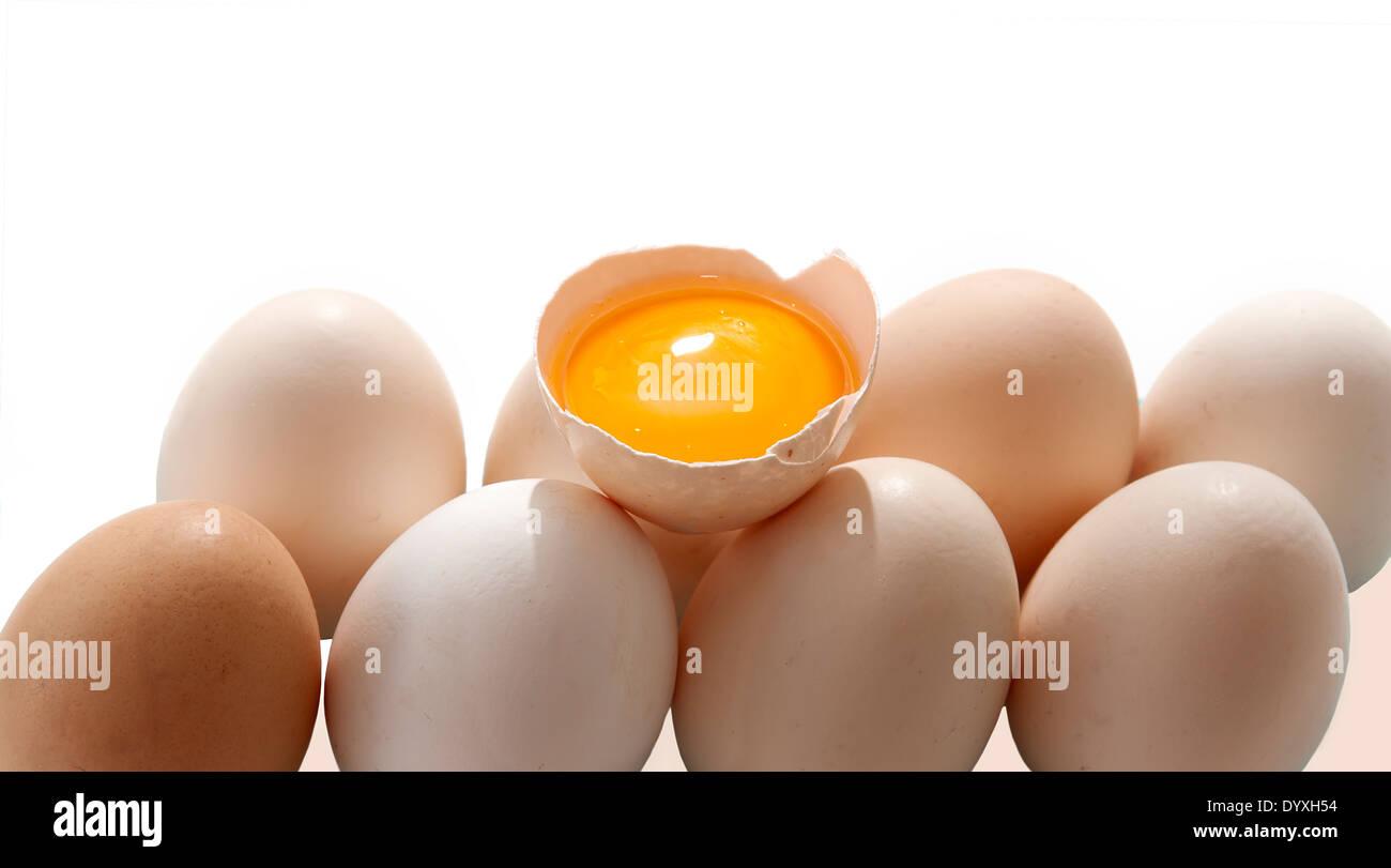 Egg yolk and eggs - Stock Image
