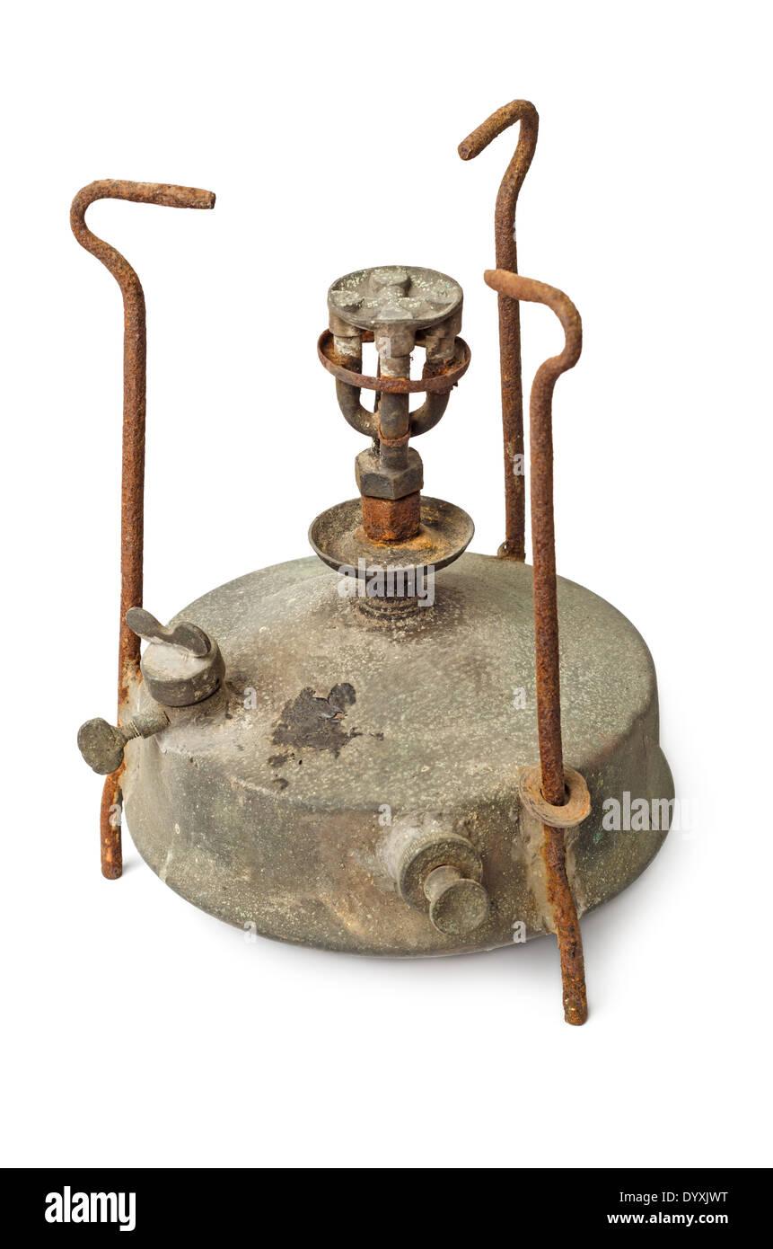 Old rusty antique kerosene stove isolated on white background - Stock Image