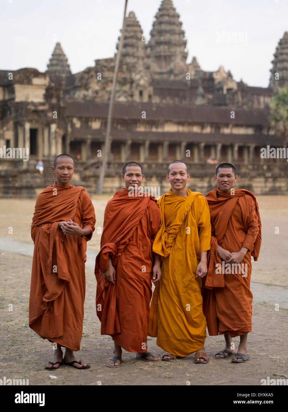 Buddhist monks in traditional robes at Angkor Wat, Siem Reap, Cambodia - Stock Image