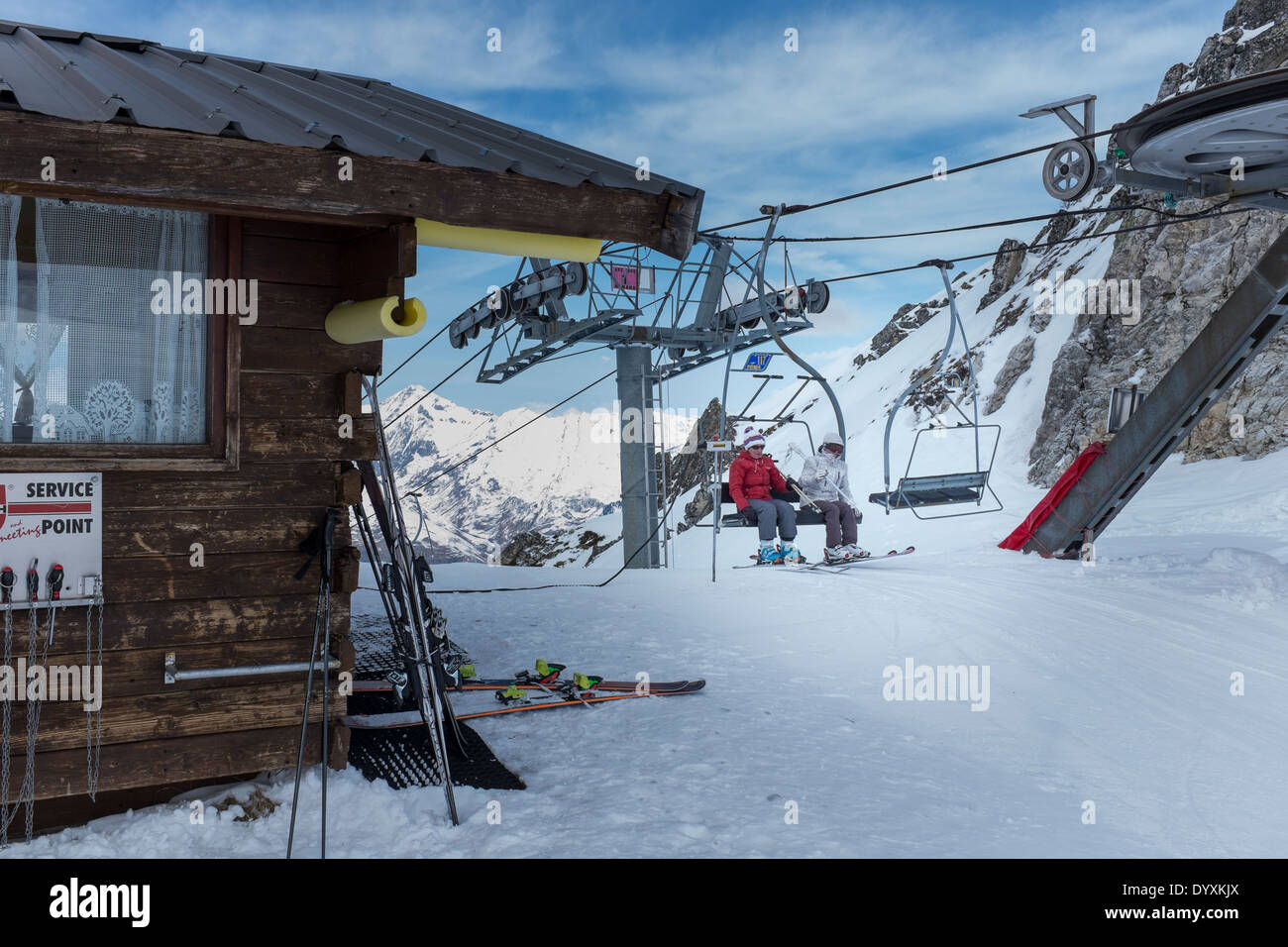 Skiers alight from the Grand Renard chairlift in Les Arcs. Stock Photo