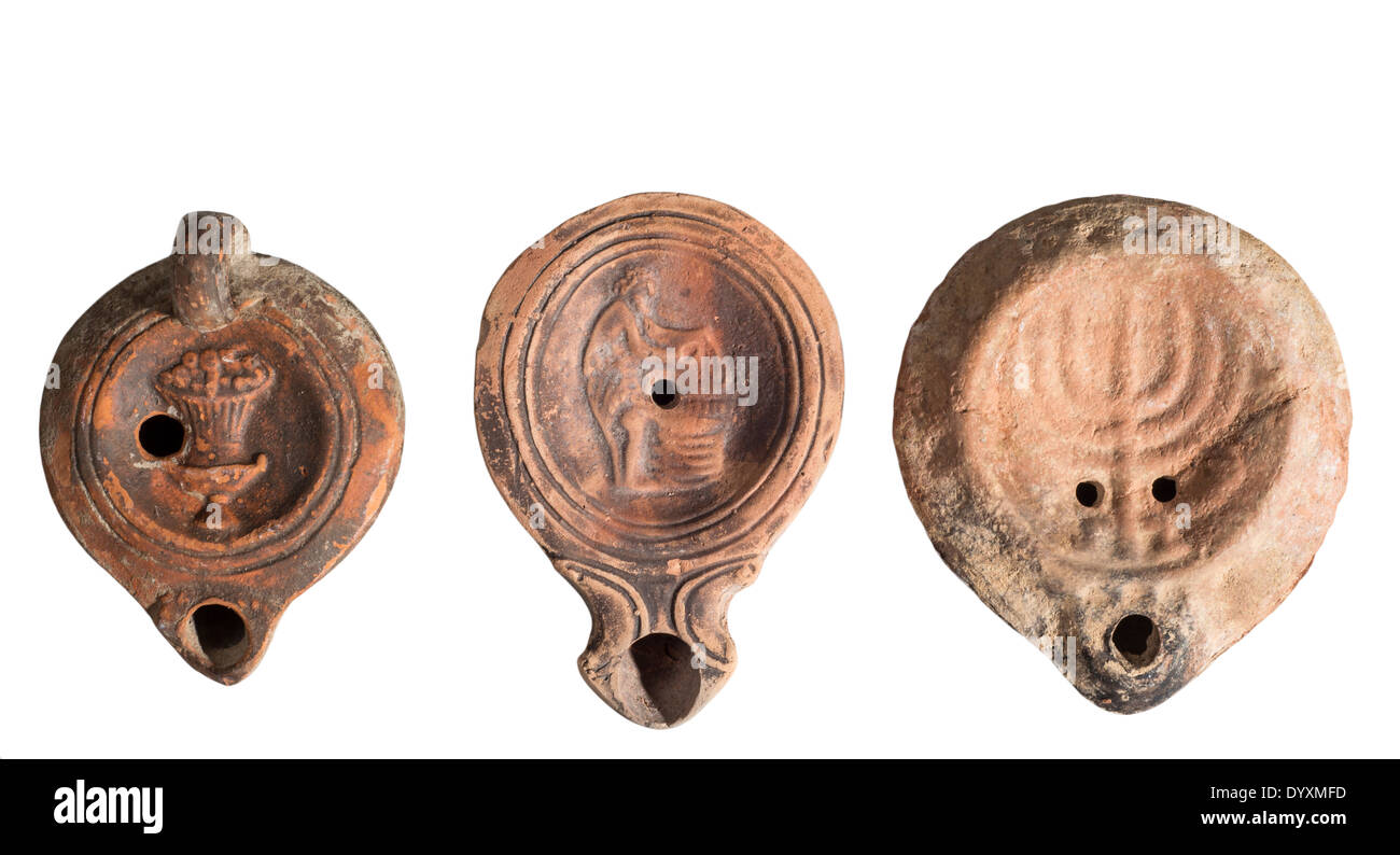 Roman period Terra-cotta Oil Lamps 3-4th century CE. The one on the right is Jewish with a seven branched Menorah - Stock Image