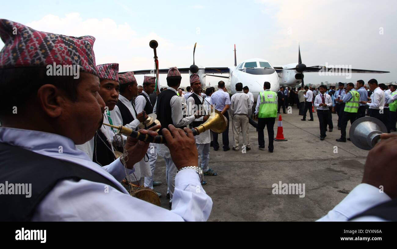(140427) -- KATHMANDU, April 27, 2014.(Xinhua) -- Traditional music players perform during the landing ceremony of a China-made air carrier, a 58-seater Modern Ark 60 (MA60), at Tribhuvan International Airport in Kathmandu, Nepal, April 27, 2014. The long wait of Nepal government to receive the first China-made air carrier has been over Sunday afternoon with the landing of MA60 at Tribhuvan International Airport. (Xinhua/Sunil Sharma)(zhf) - Stock Image