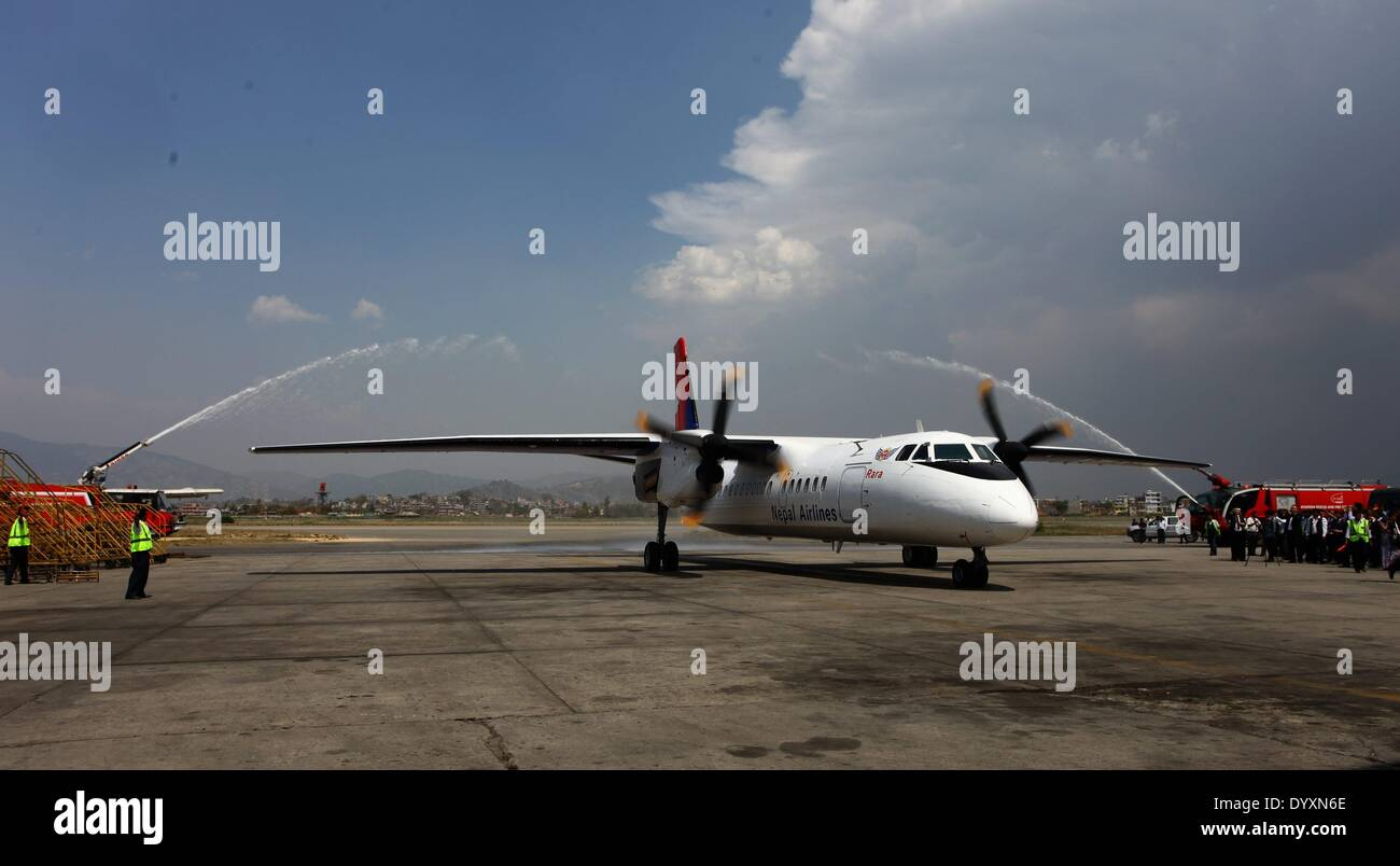 (140427) -- KATHMANDU, April 27, 2014.(Xinhua) -- A China-made air carrier, a 58-seater Modern Ark 60 (MA60), lands on Tribhuvan International Airport in Kathmandu, Nepal, April 27, 2014. The long wait of Nepal government to receive the first China-made air carrier has been over Sunday afternoon with the landing of MA60 at Tribhuvan International Airport. (Xinhua/Sunil Sharma)(zhf) - Stock Image