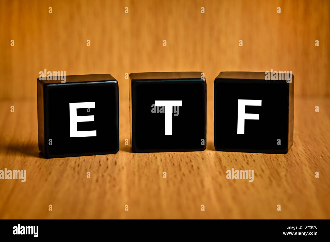 ETF or Exchange Traded Fund text on black block Stock Photo