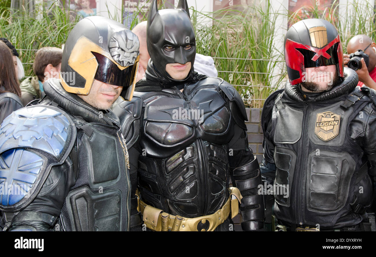 London, UK. 27th Apr, 2014. Sci-Fi Costume Parade Man in Batman Costume with Two Judges from  Judge Dredd either side. Credit:  Prixpics/Alamy Live News - Stock Image