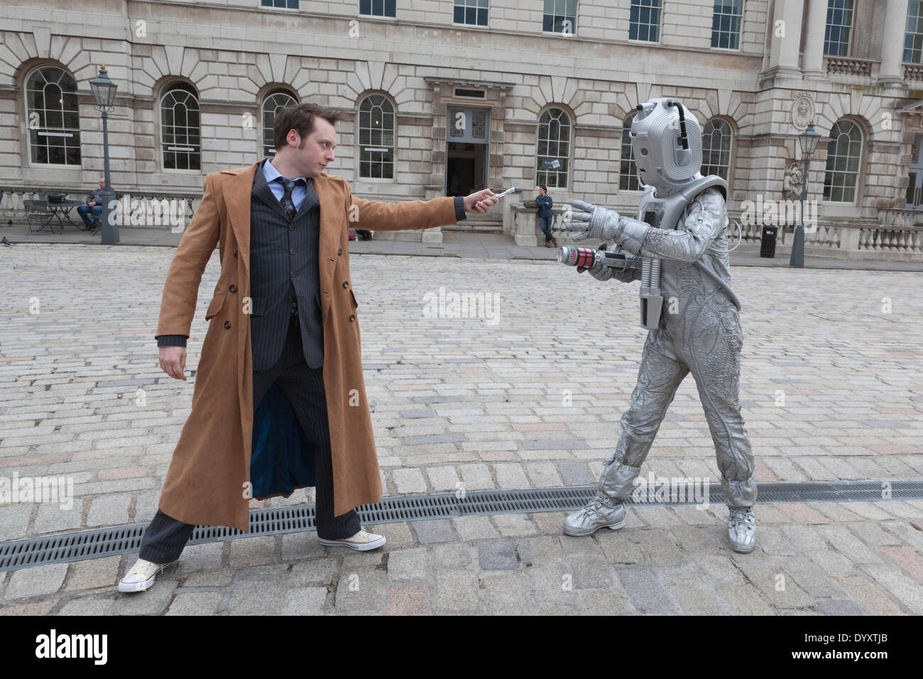 London, UK. 27 April 2014. The Doctor fights a Cyberman. Sci-Fi fans gathered in the Courtyard of Somerset House, London, and dressed up as their favourite science fiction character ahead of a parade through London. This 4th annual parade was organised by Sci-Fi London 14, the London International Festival for Science Fiction and Fantastic Film which runs unil May 4th. Photo: Nick Savage/Alamy Live News - Stock Image