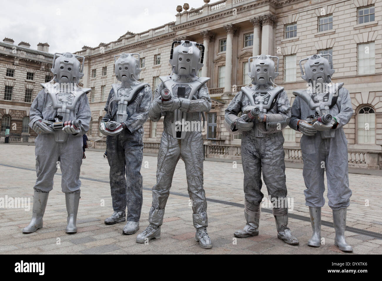 London, UK. 27 April 2014. Cybermen in the Courtyard of Somerset House. Sci-Fi fans gathered in the Courtyard of Somerset House, London, and dressed up as their favourite science fiction character ahead of a parade through London. This 4th annual parade was organised by Sci-Fi London 14, the London International Festival for Science Fiction and Fantastic Film which runs unil May 4th. Photo: Nick Savage/Alamy Live News - Stock Image
