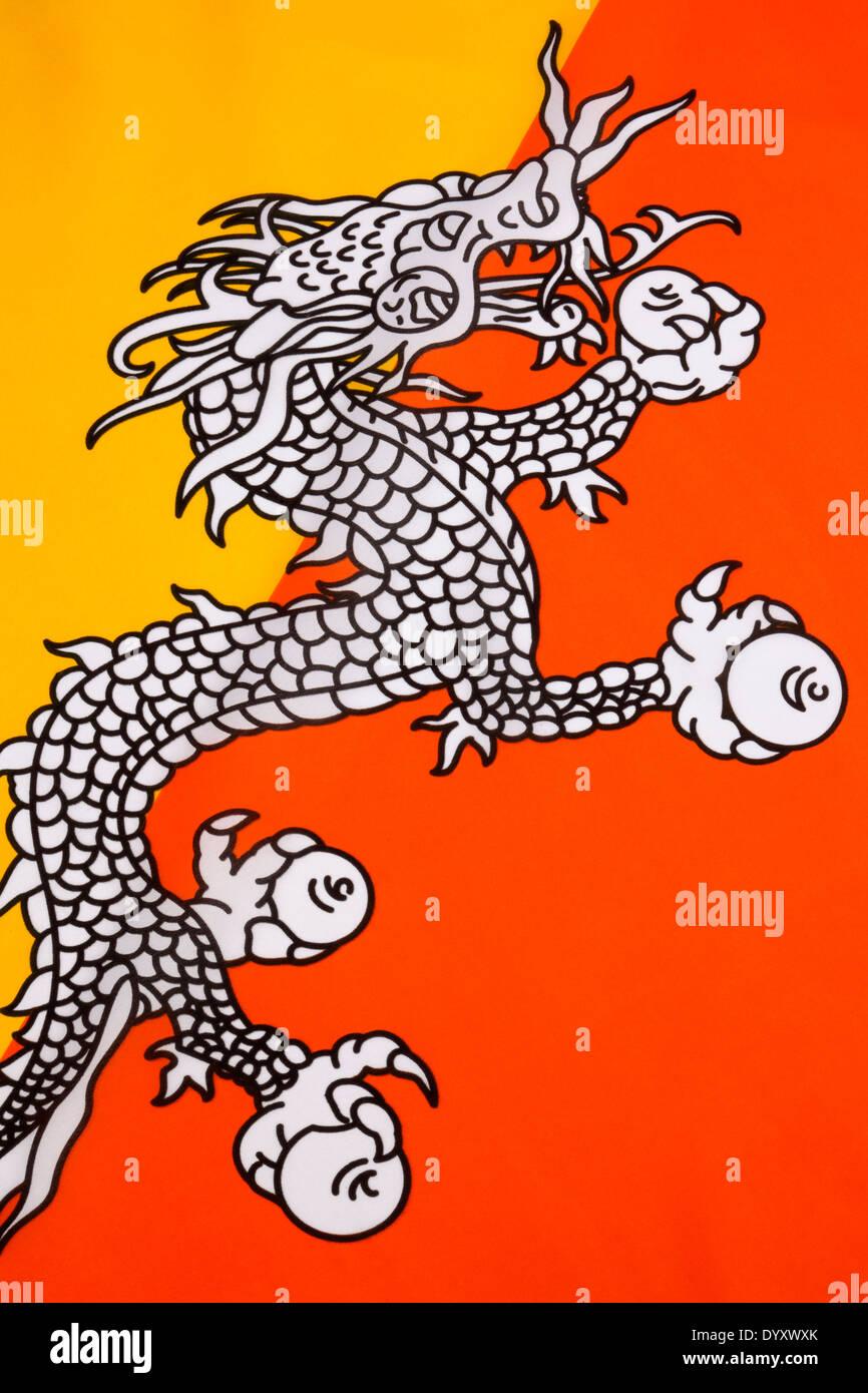 The national flag of The Kingdom of Bhutan - Stock Image
