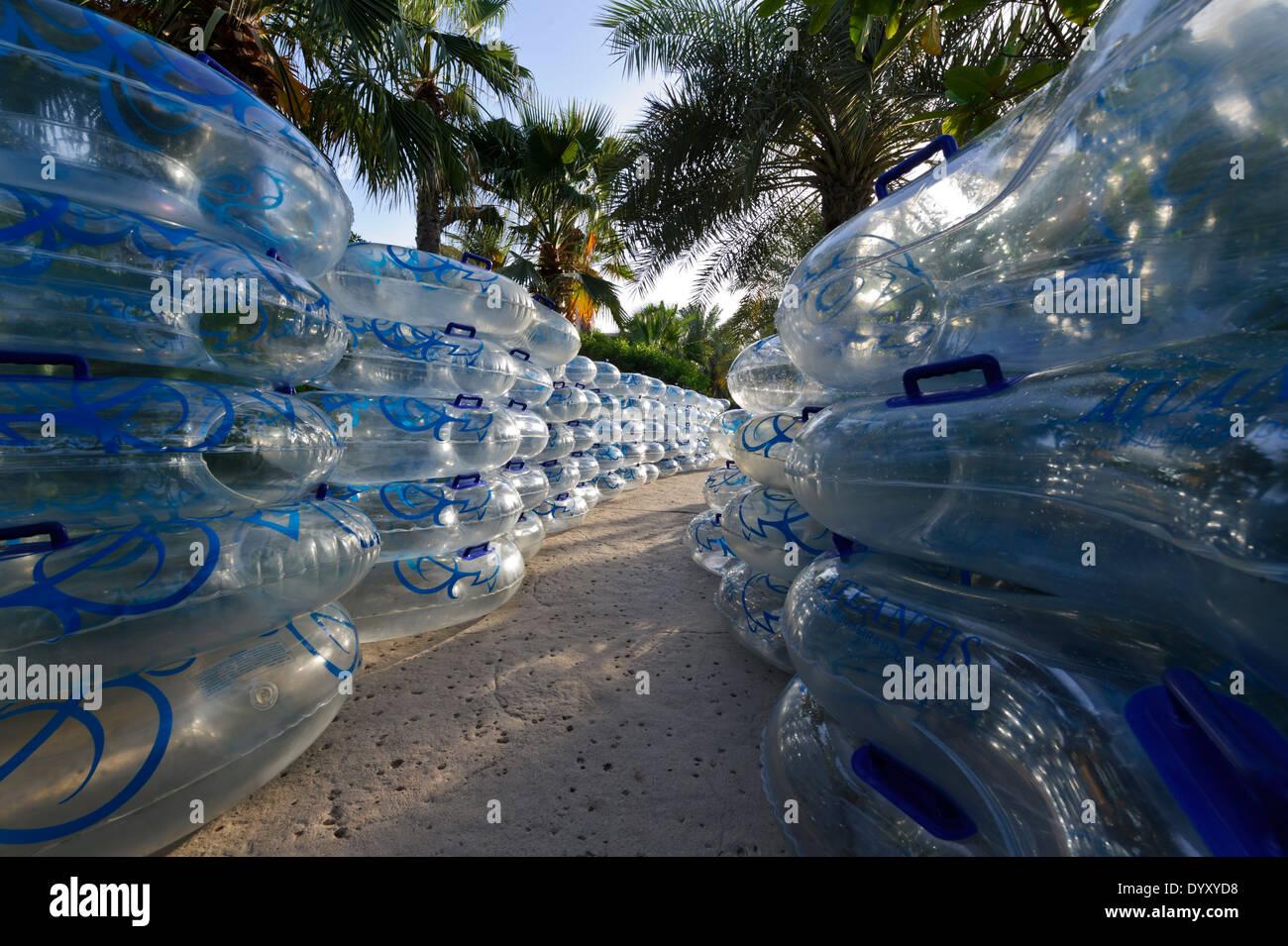 Plastic floaters used by tourists at the Atlantis, The Palm Hotel, Dubai, United Arab Emirates, UAE. - Stock Image