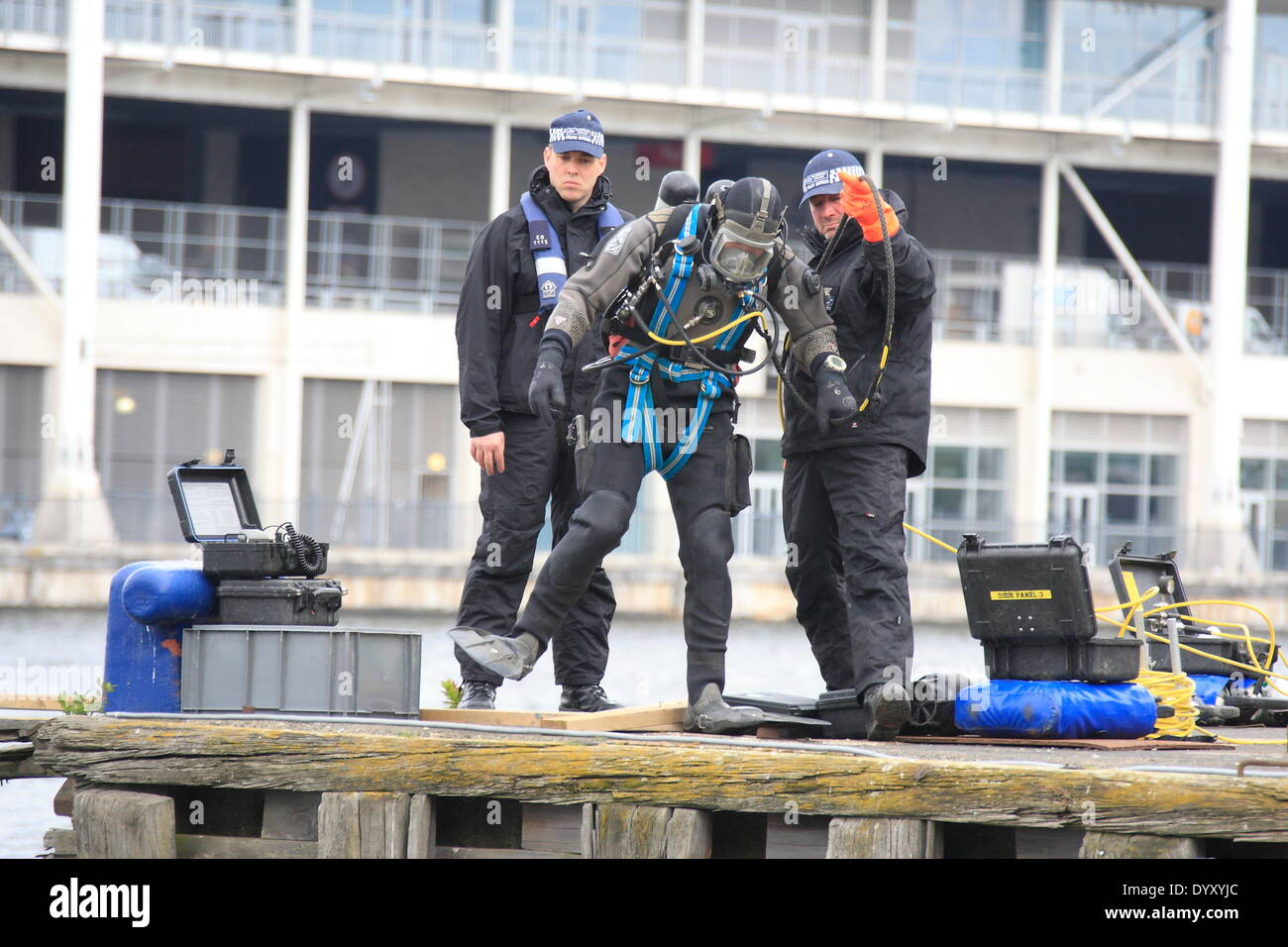 London, UK. Sunday April 27th 2014 Metropolitan Police Marine Unit searches the Royal Victoria Docks for a plane's black boxes as part of the large multi agency exercise being held in East London. The three day exercise sees hundreds of emergency services personnel responding to a simulated plane crash at the Millennium Mills site and adjacent Royal Victoria Docks. Credit:  HOT SHOTS/Alamy Live News - Stock Image