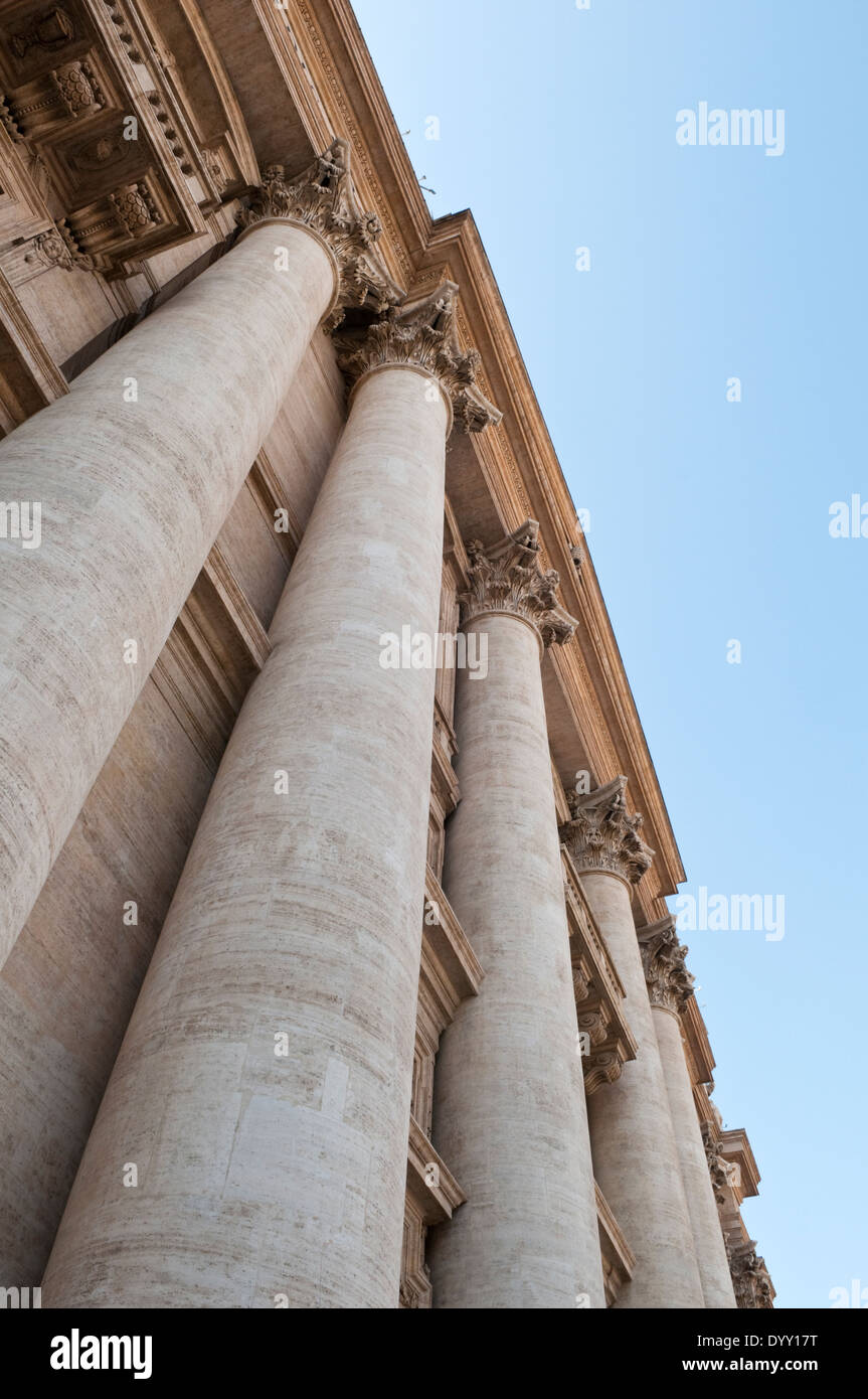 View looking up the Corinthian columns on the facade of of St. Peter's Basilica in Vatican City - Stock Image