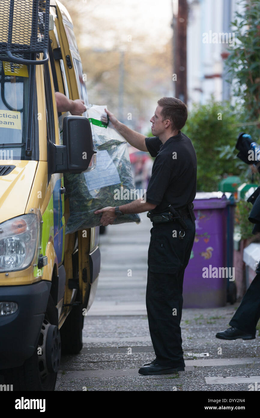 Liverpool, UK. 27th Apr, 2014. Merseyside Police remove large bags of marijuana from a house near Allerton Road in Liverpool Credit:  Adam Vaughan/Alamy Live News - Stock Image