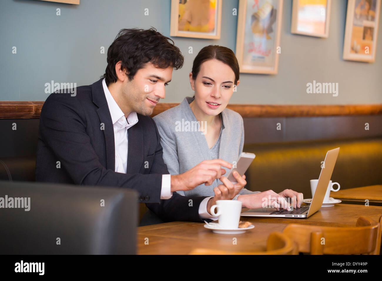 Business woman man computer colleague restaurant Stock Photo