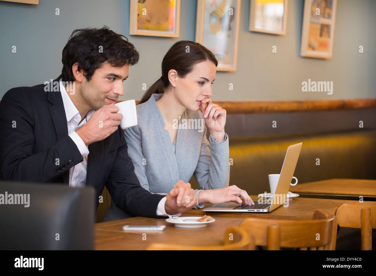 Business woman man computer colleague restaurant Stock Photo