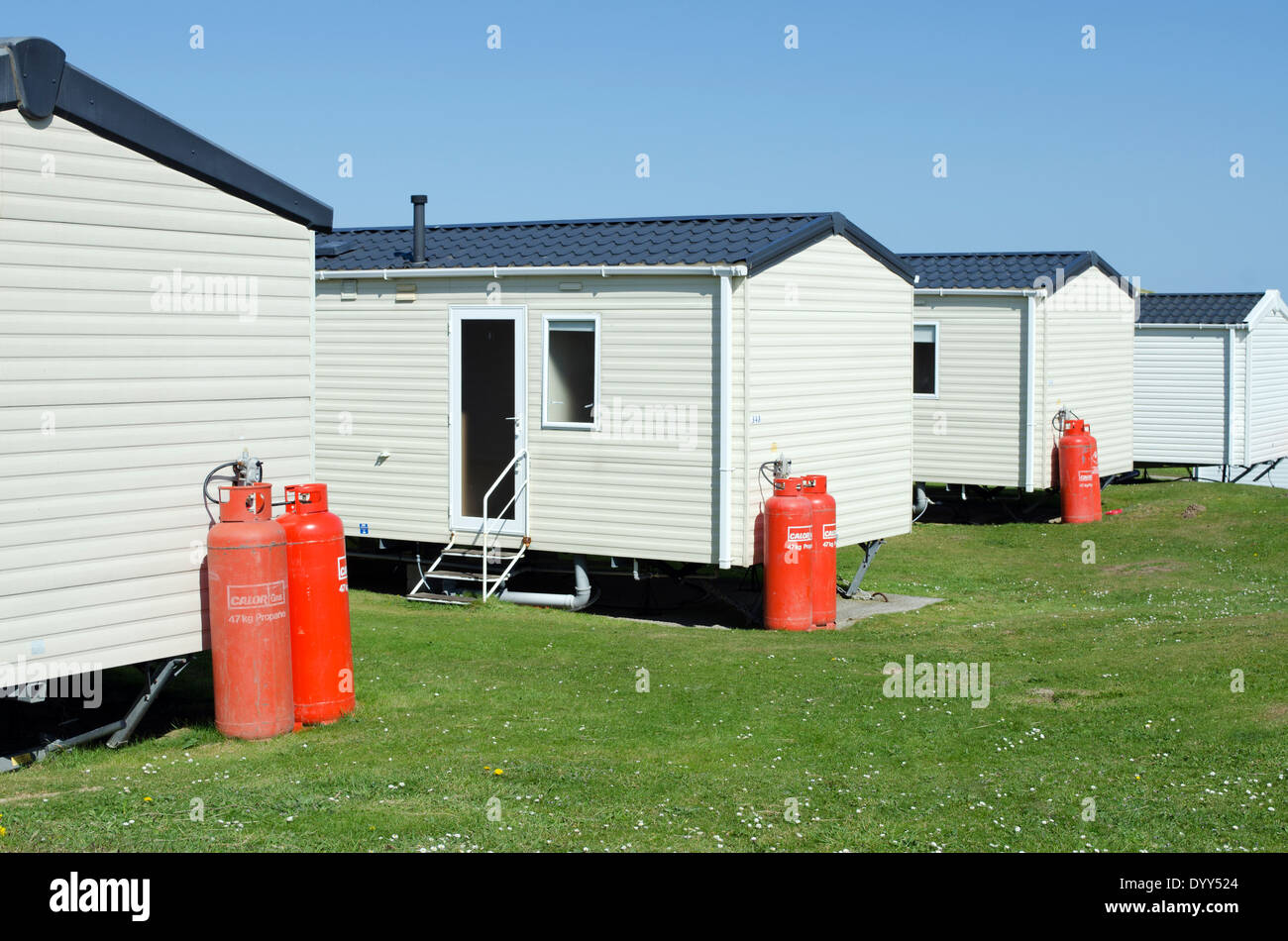 holiday caravans with propane gas bottles for fuel supply - Stock Image