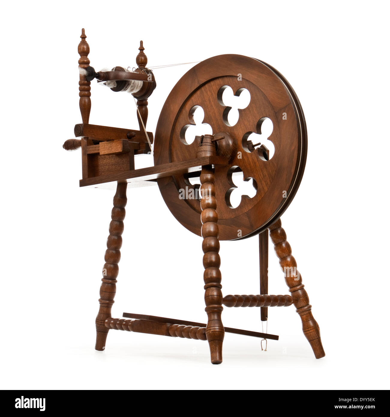 Wooden handmade spinning wheel against white background Stock Photo