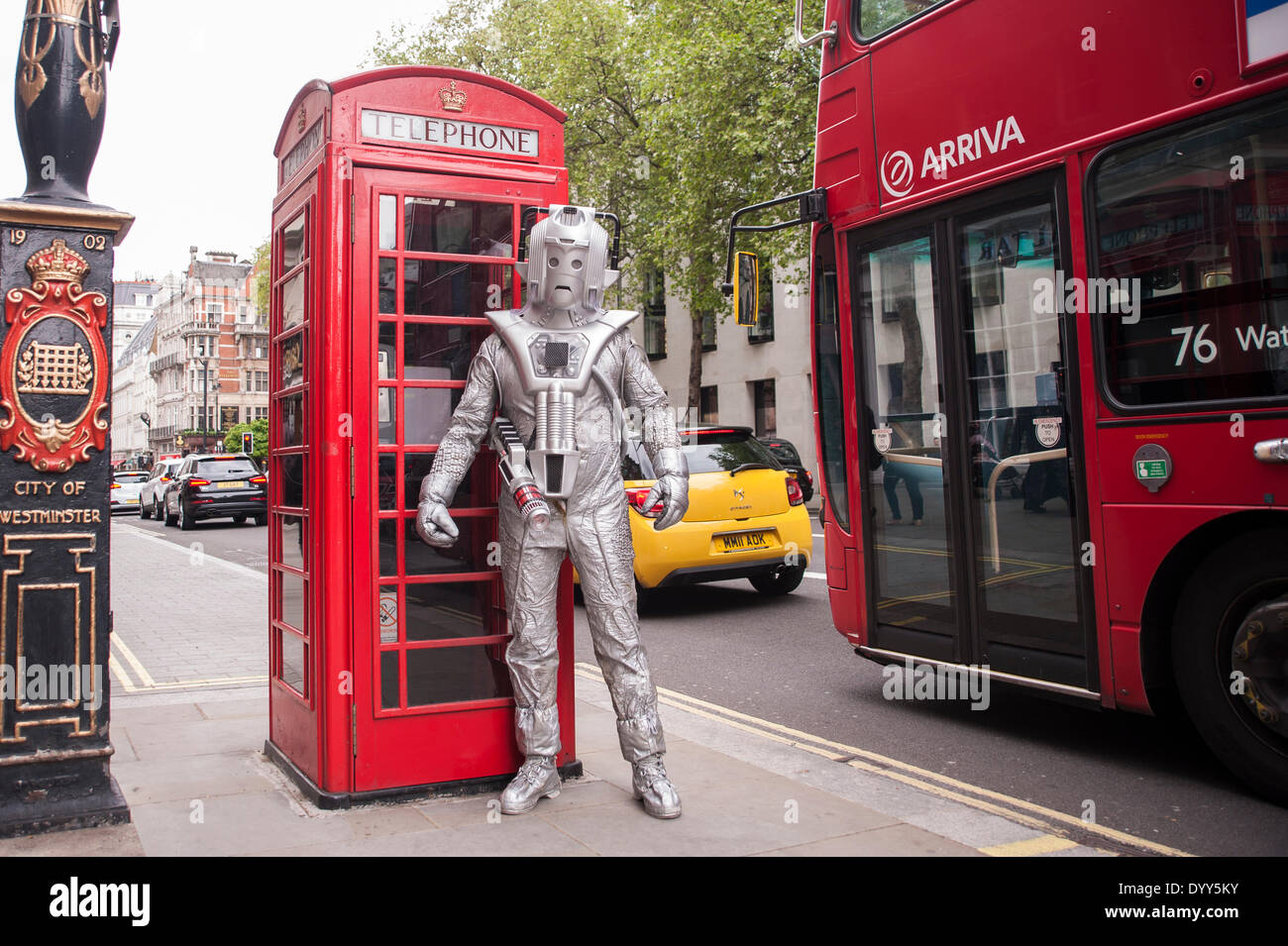 London, 27 April 2014 - people dressed as their favourite sc-fi characters take part in the Sci-Fi London 2014 costume parade starting at Somerset House and finishing at the BFI on the South Bank.  A Cyberman, from Doctor Who, stand by a telephone box.      Credit:  Stephen Chung/Alamy Live News - Stock Image