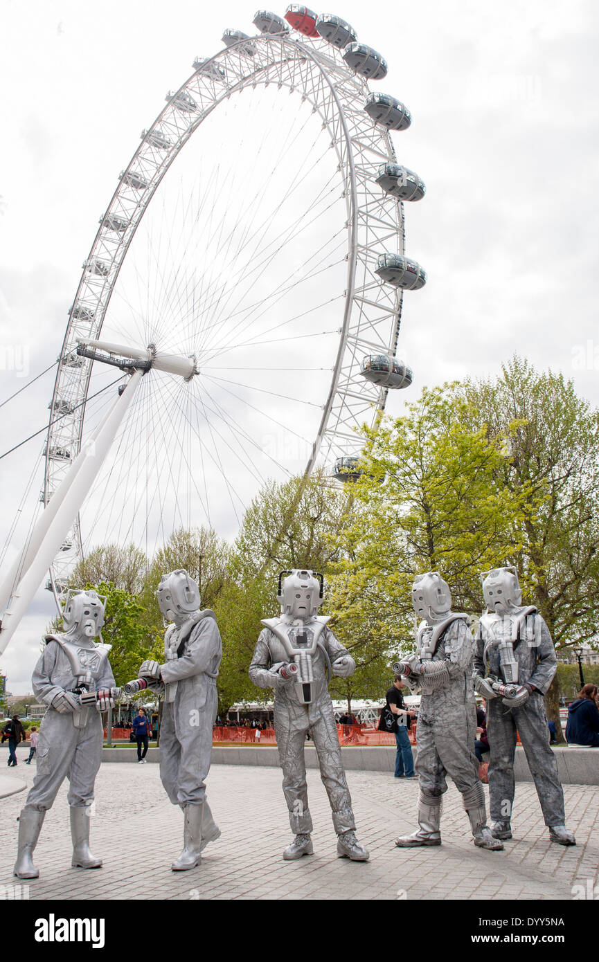London, 27 April 2014 - people dressed as their favourite sci-fi characters take part in the Sci-Fi London 2014 costume parade starting at Somerset House and finishing at the BFI on the South Bank.  Cybermen gather near the London Eye.    Credit:  Stephen Chung/Alamy Live News - Stock Image